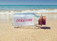 bullying message in bottle shutterstock 208955578 300x227