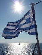 greece flag and sailboat